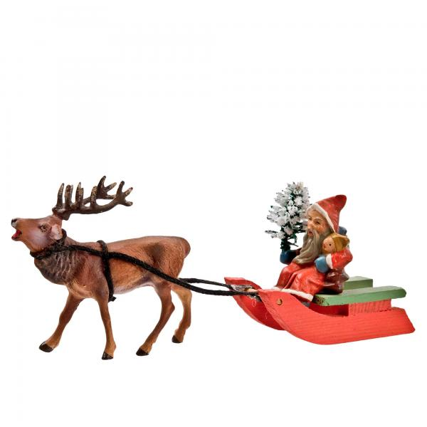 Miniature Santa on sledge with stag