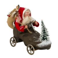 Dressed Santa Claus sitting in a shoe with wheels
