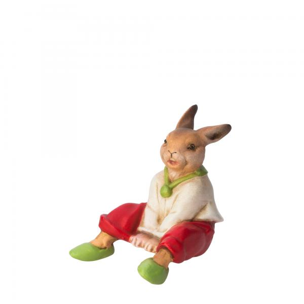 Sitting rabbit boy with white jacket